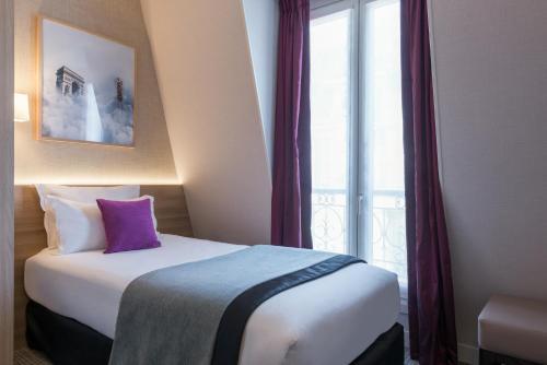 chambre solo 2 - hôtel maga champs-élysées